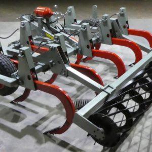 Chisel plough hydraulic reset